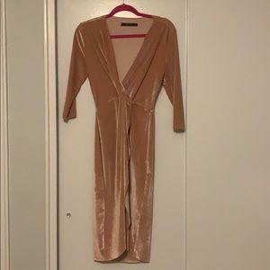 Rose gold velvet high low dress.